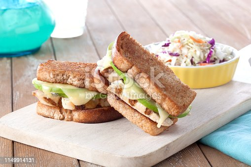 roasted chicken and apple sandwich on wheat bread with coleslaw side