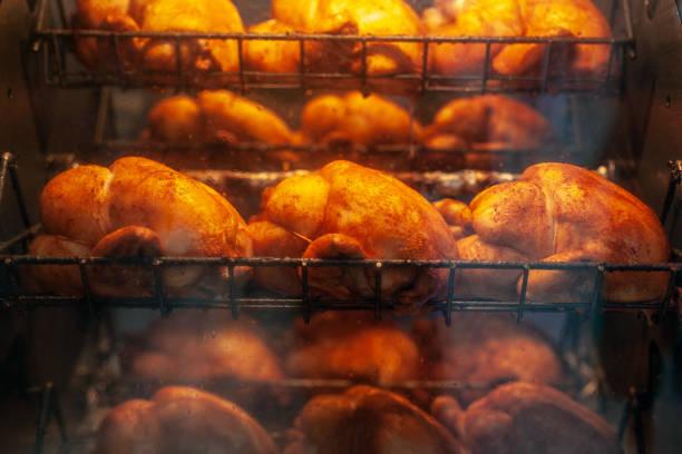 chicken at the spit - girarrosto foto e immagini stock