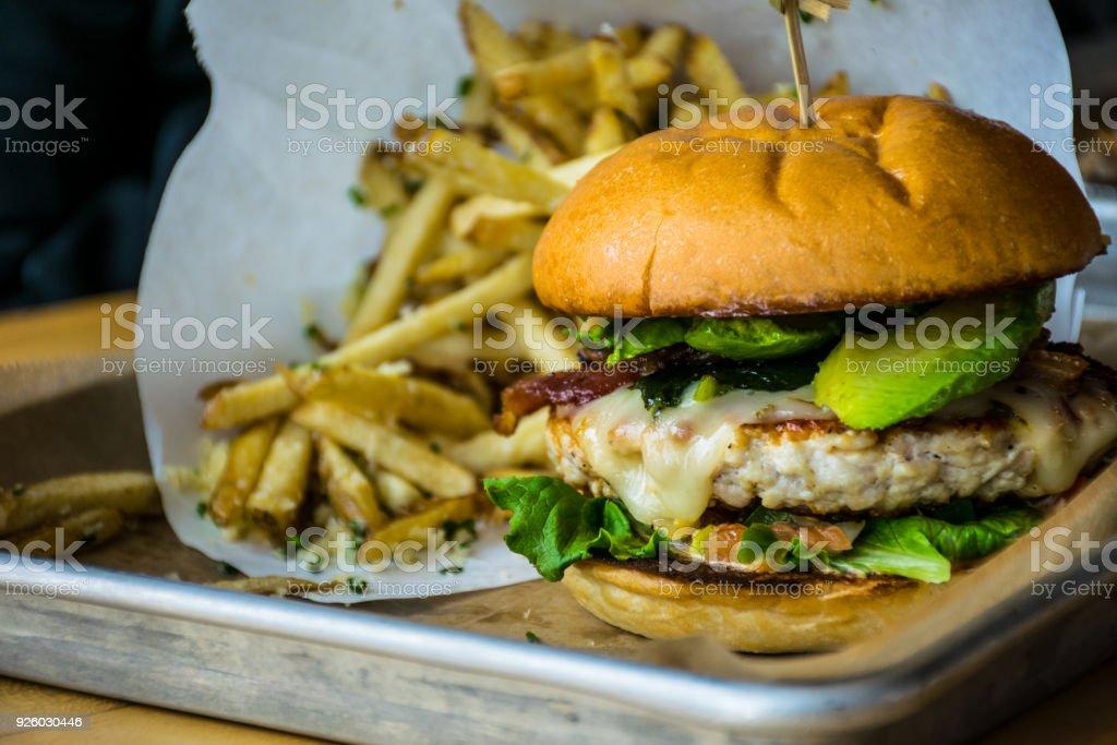 Chicken Avocado Bacon Burger hamburger stock photo