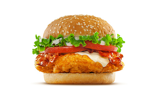 High resolution, digital capture of a fried chicken club sandwich with lettuce, tomatoes, mayonnaise, cheese, and crispy bacon, on a fresh sesame seed bun, set against a clean, white background sweep. Shot in an aspirational advertising style.
