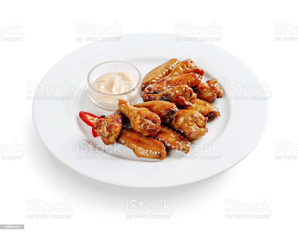 chicken baked in honey sauce. on a white background stock photo