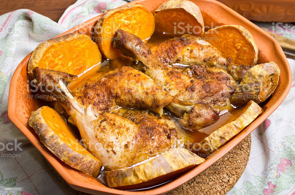 Chicken baked in traditional clay roman pot stock photo