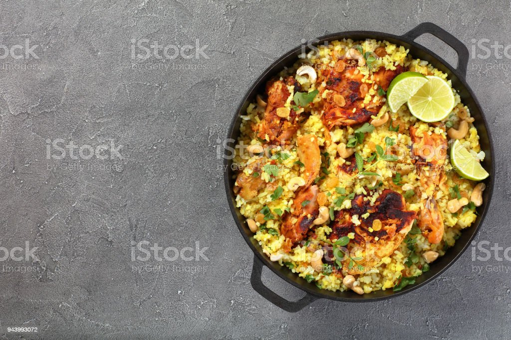 chicken biryani n cast iron pan stock photo