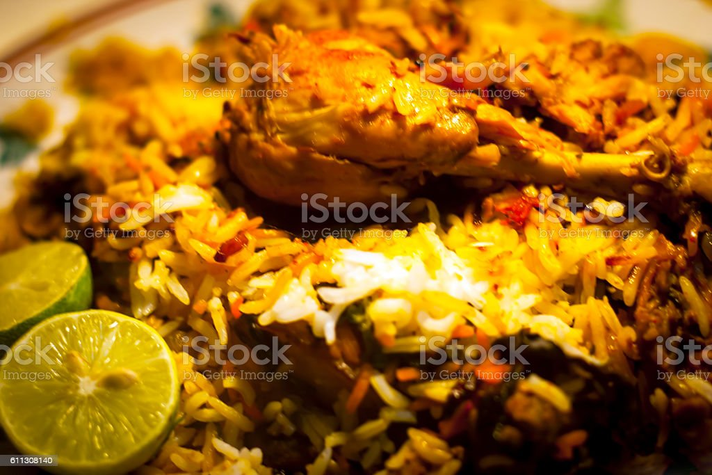 Chicken Biryani with chicken legs on the top. stock photo