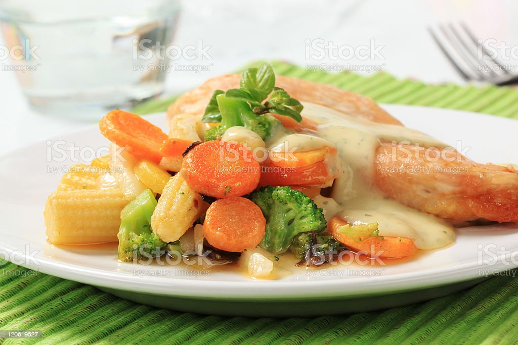 Chicken breast and mixed vegetables poured with sauce royalty-free stock photo