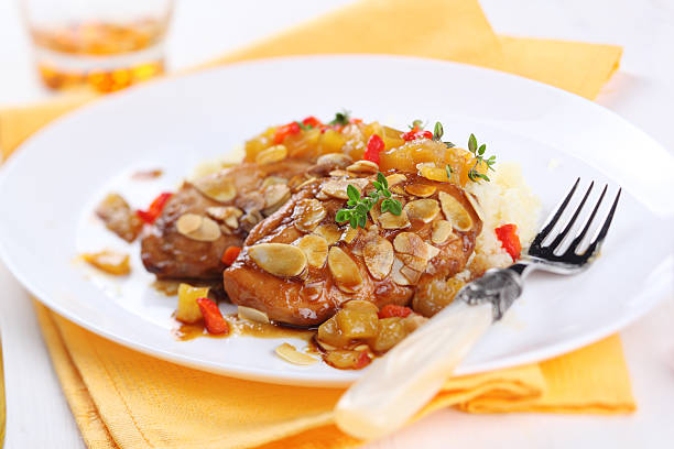 Chicken breast baked with almonds and apricot sauce stock photo