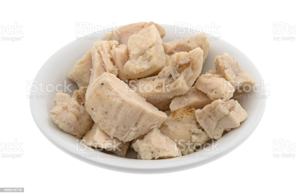 Chicken breast chunks in a small bowl stock photo