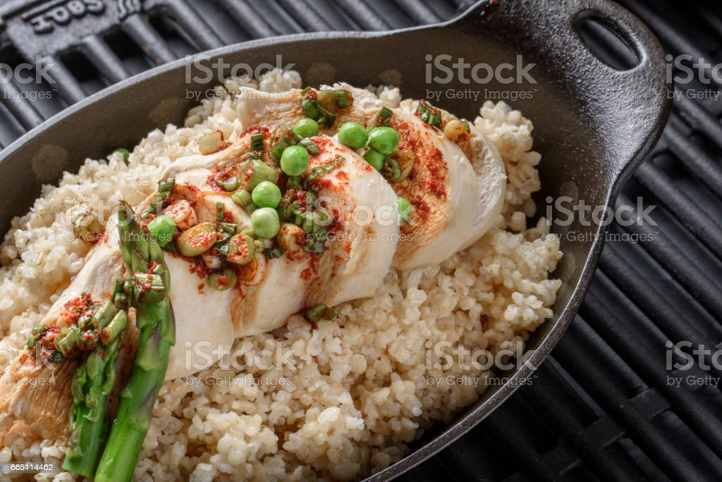 Chicken Breast over Brown Rice stock photo