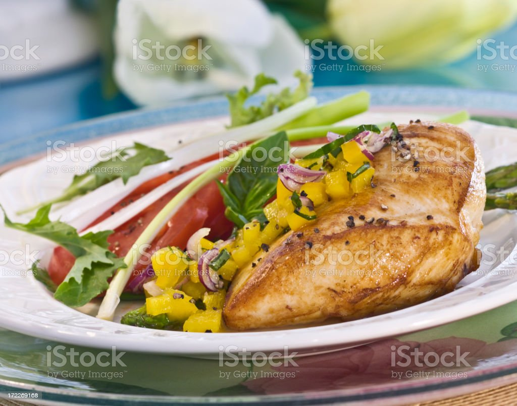 chicken breast with baby greens stock photo