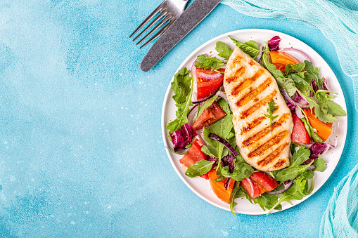 istock Chicken breast with fresh salad 1040846976