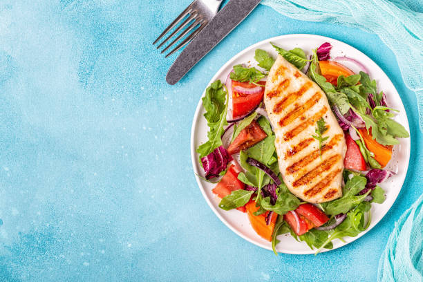 Chicken breast with fresh salad Chicken breast with fresh salad, top view. grilled chicken breast stock pictures, royalty-free photos & images