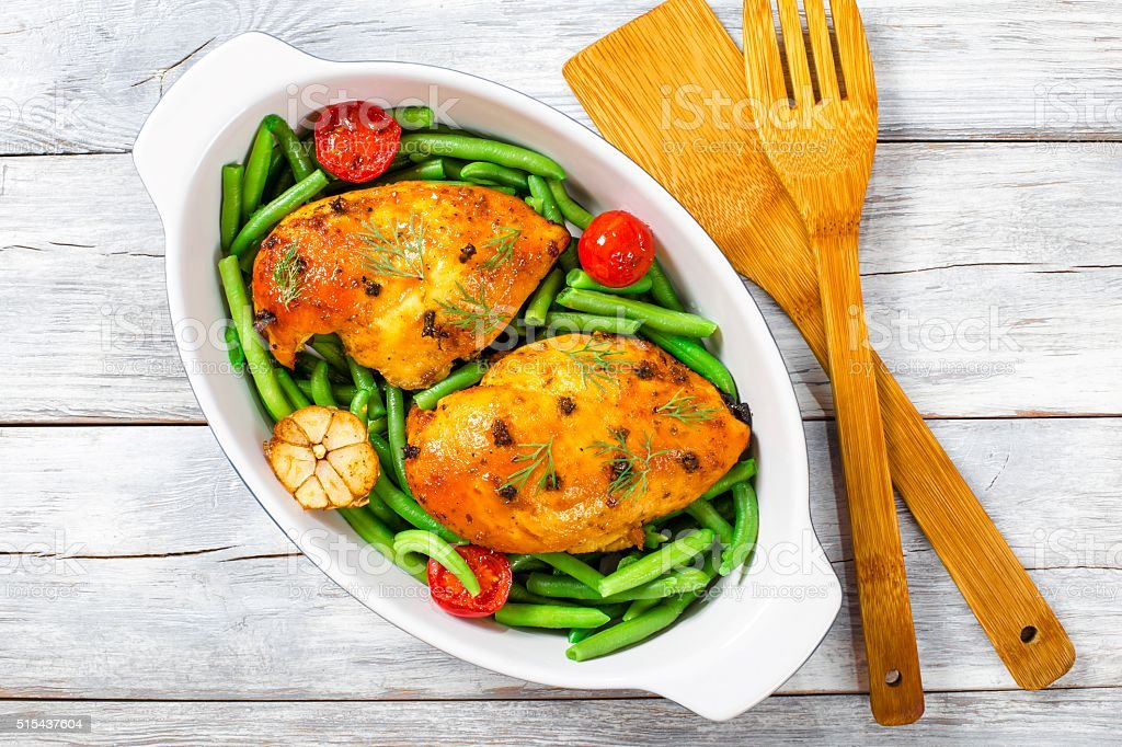 Chicken breast with green beans, garlic and tomatoes stock photo