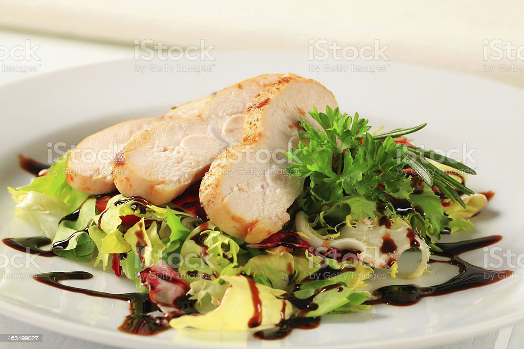 Chicken breast with green salad stock photo
