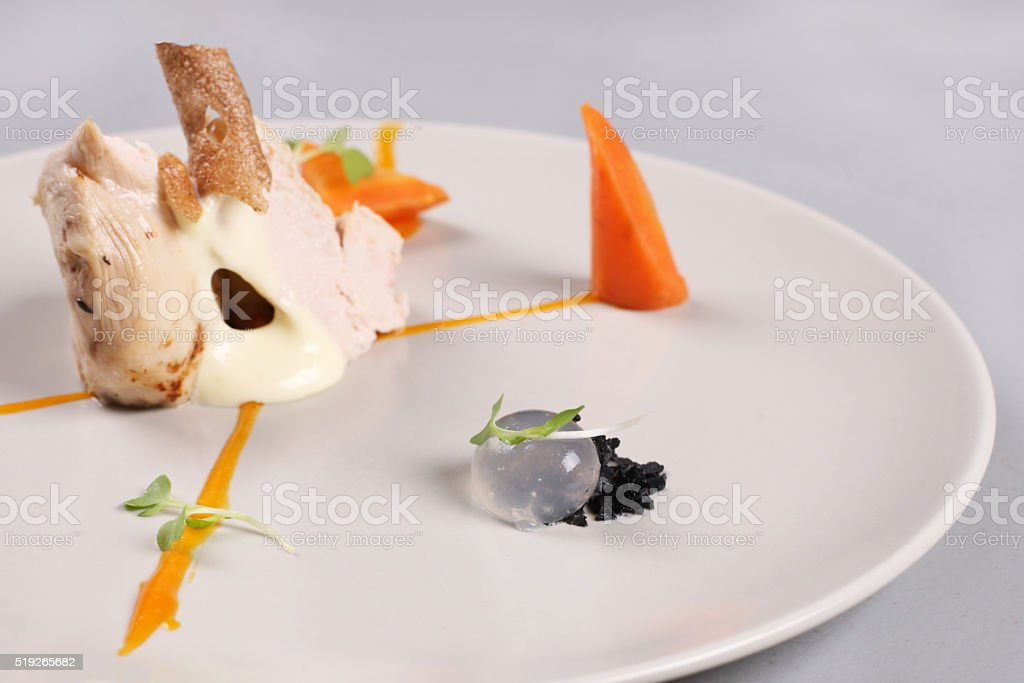 chicken breast with vegetables on a white plate. stock photo