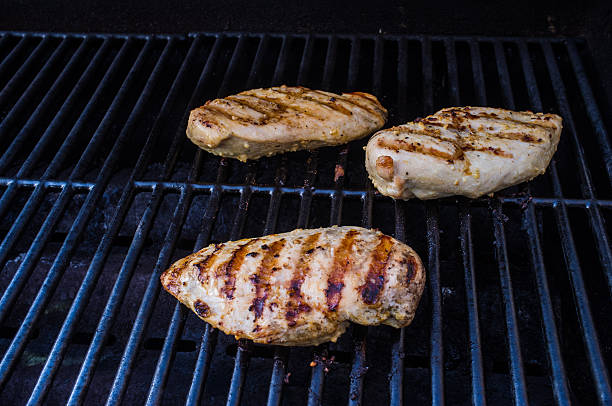 Chicken breasts on the BBQ stock photo