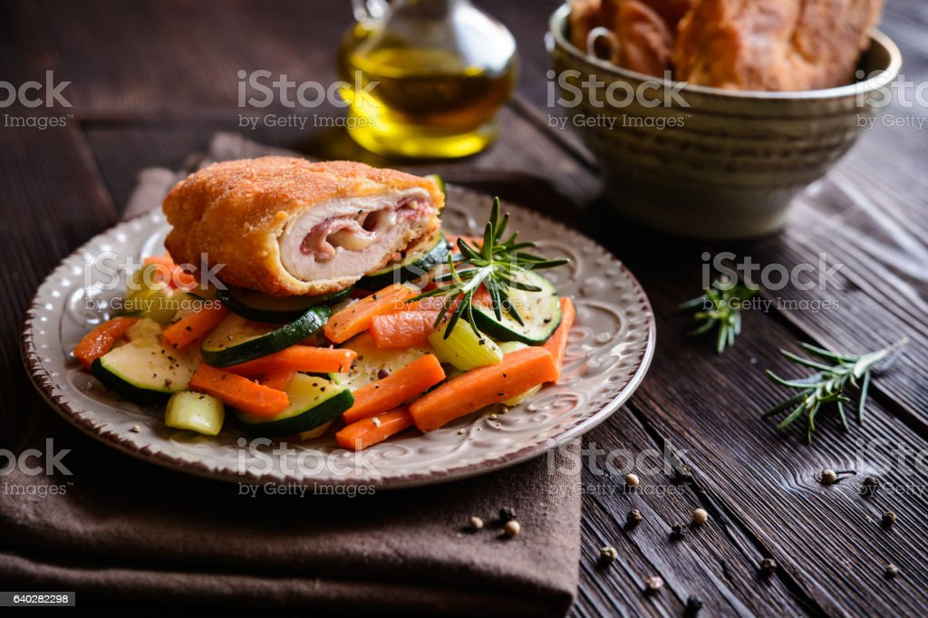 Chicken breasts stuffed with bacon and cheese stock photo