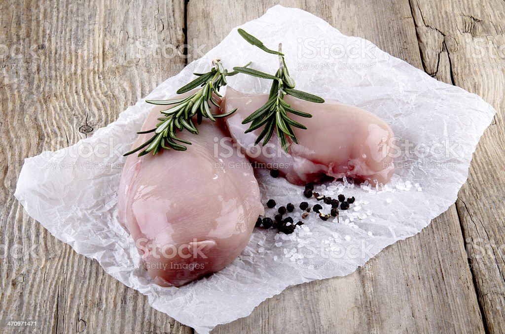 Chicken breasts with rosemary sea salt and peppercorns stock photo