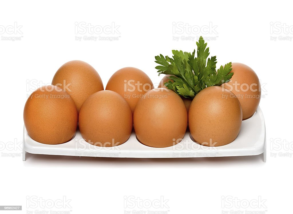 Chicken brown eggs in container royalty-free stock photo