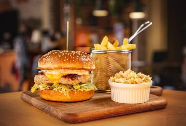 Chicken burger in brioche bun stock photo