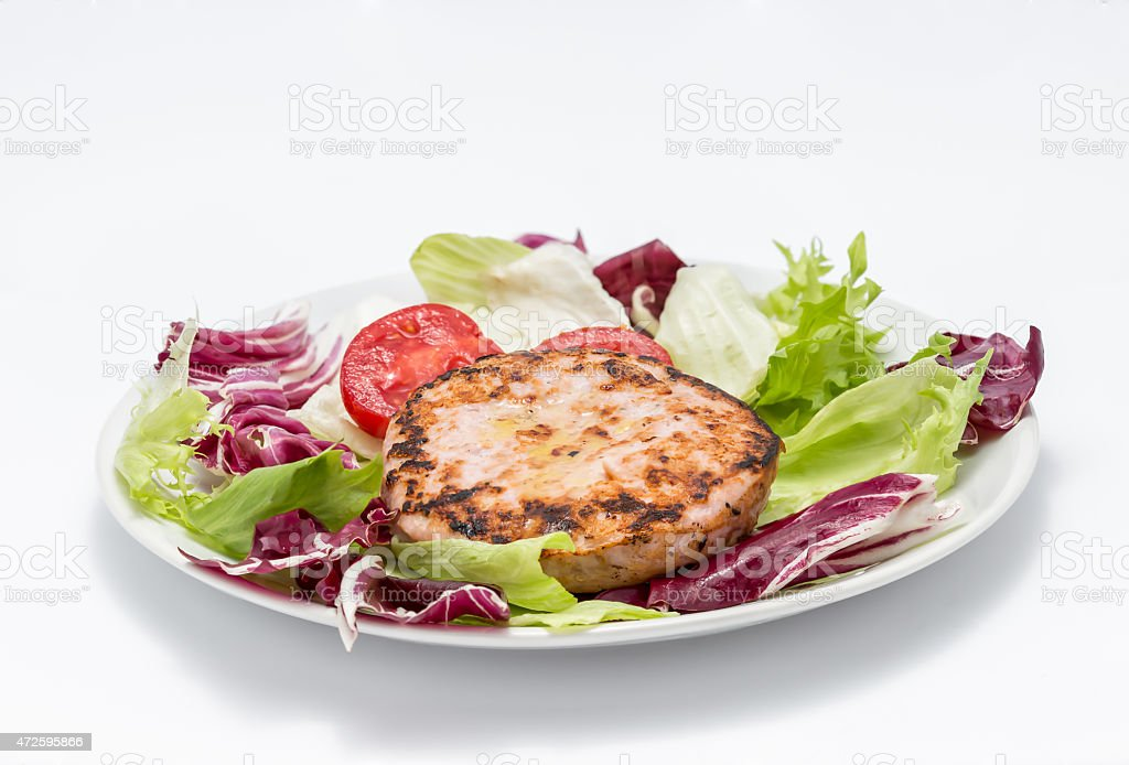 Chicken burger over salad stock photo