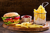 istock chicken burger with french fries 865787124