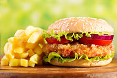 istock chicken burger with french fries 865789368