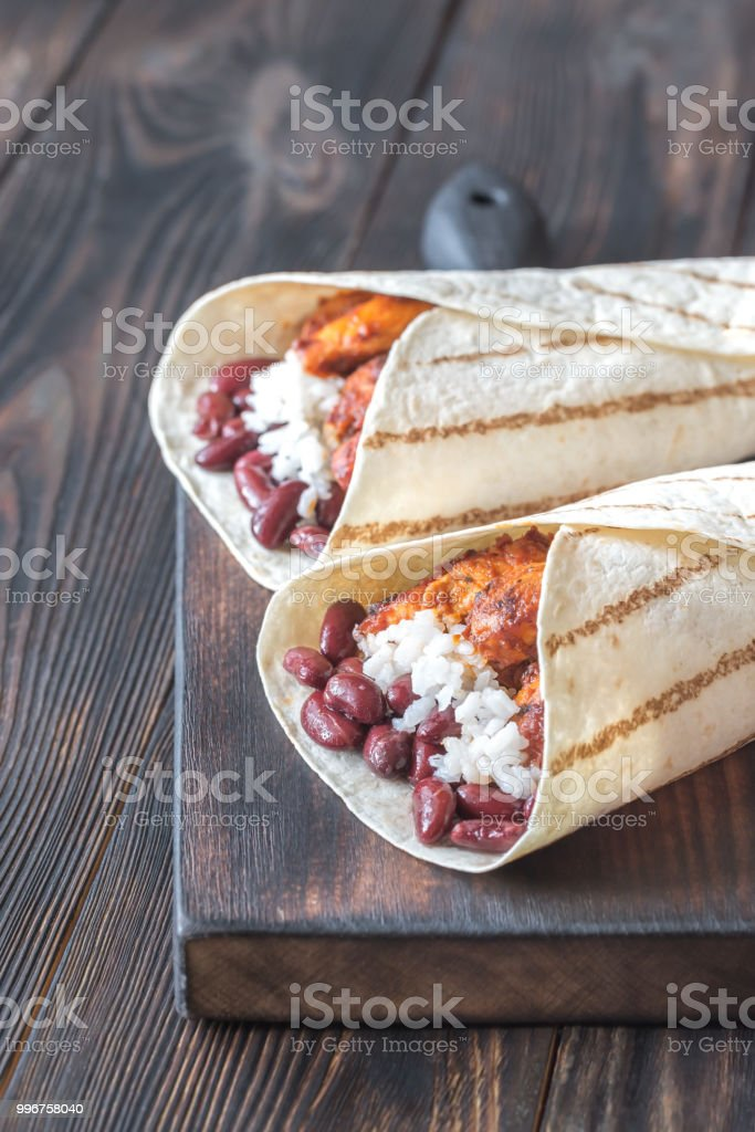 Chicken burritos on the wooden board stock photo
