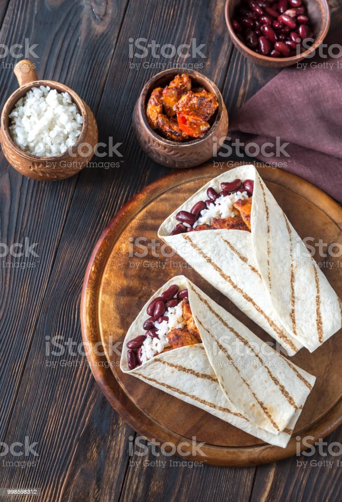 Chicken burritos with ingredients stock photo