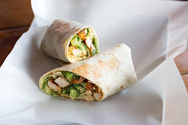 chicken caesar salad sandwich wraps - pollo foto e immagini stock