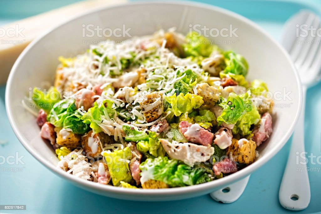 Chicken caesar salad with bacon, parmesan and herb croutons stock photo