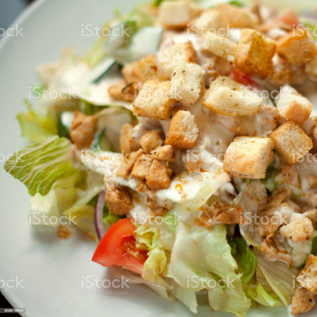 Chicken Caesar Salad with croutons. royalty-free stock photo