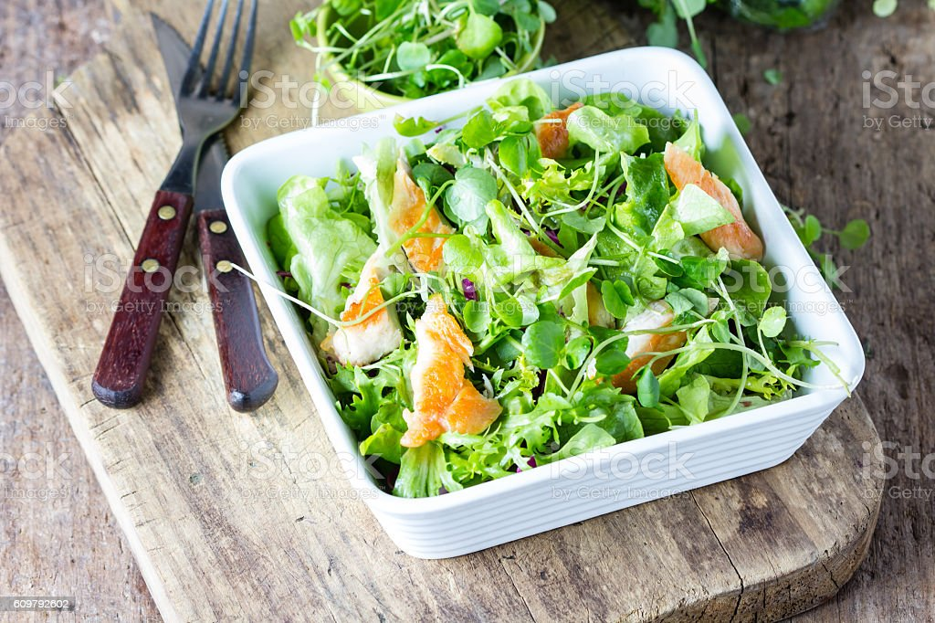 Chicken caesar salad with lettuce and arrugula stock photo