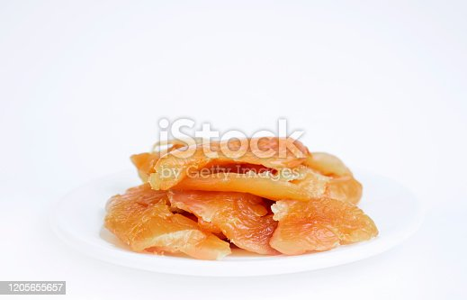 Chicken carpaccio fillet on a white plate isolated on a white background. Delicacies. Italian food. Copy space