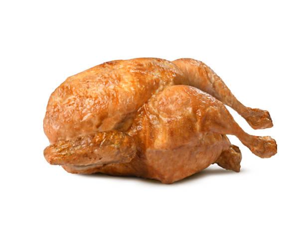 chicken cooked on a rotisserie - girarrosto foto e immagini stock