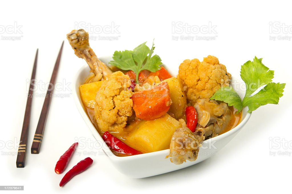 Chicken curry dish with potato and cauliflower on white royalty-free stock photo