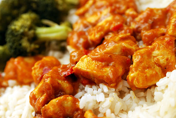 Chicken curry server over rice stock photo