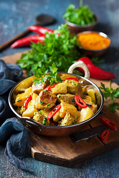 chicken curry with pineapple - caribbean food stock photos and pictures