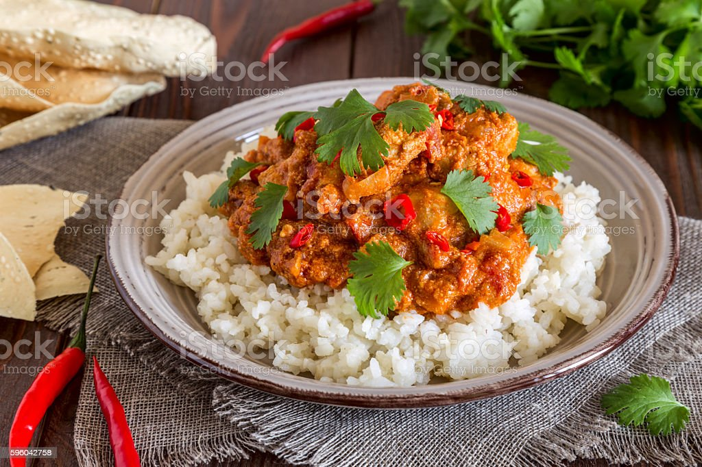 Chicken curry with rice and cilantro. royalty-free stock photo