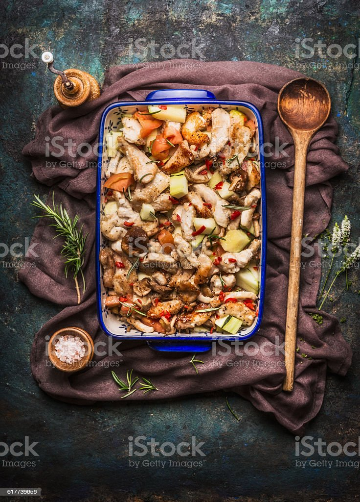 Chicken dish with vegetables and cooking spoon stock photo