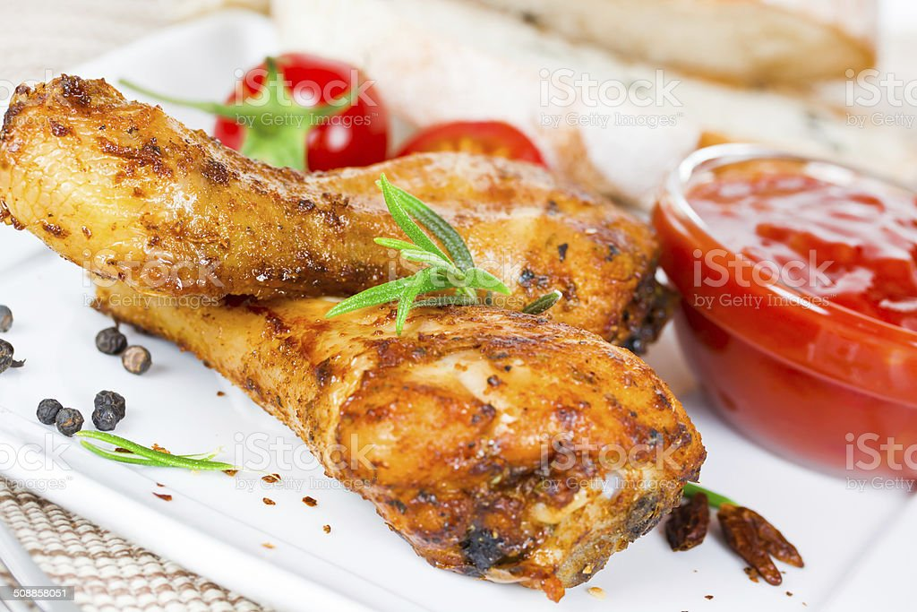 chicken drumsticks stock photo