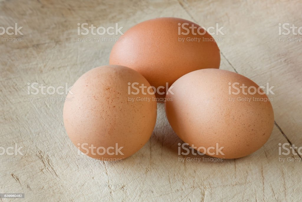 Chicken eggs on an old, wooden background stock photo