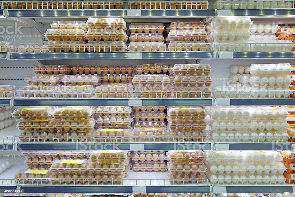 Chicken eggs on supermarket shelves stock photo