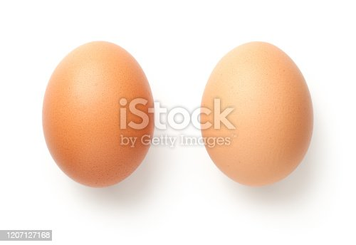 Chicken eggs isolated on white background. Flat lay, top view