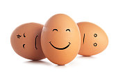 istock Chicken eggs with funny emoticons isolated on white background 1147811200