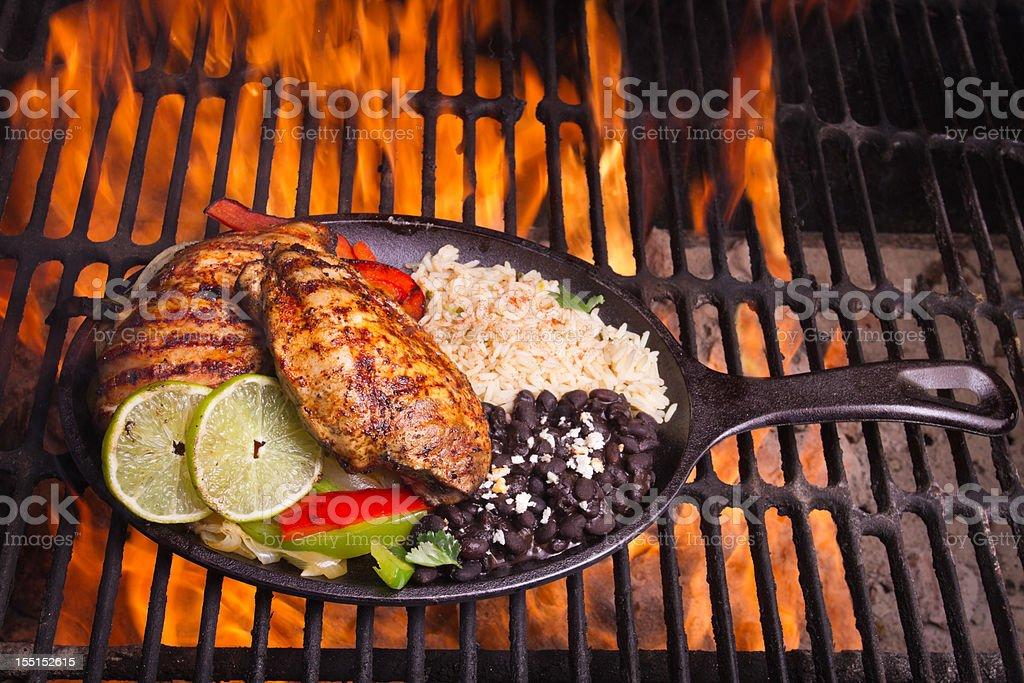Chicken Fajitas with flames stock photo
