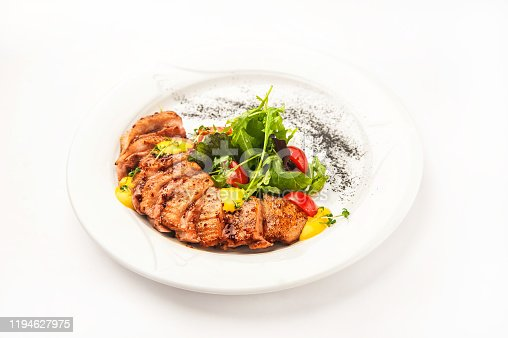 Chicken fillet in a restaurant close-up. Wild duck fillet with vegetables on a white plate and copy space.