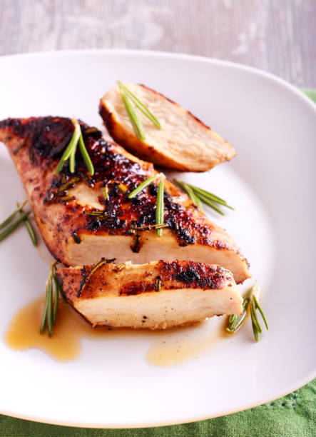 Chicken fillet with mustard and rosemary stock photo