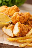 Chicken fingers with french fries and honey mustard.  Please see my portfolio for other food related images.