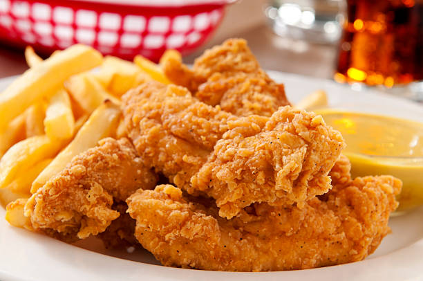 Chicken Fingers Chicken fingers with french fries and honey mustard and a cold soda.  Please see my portfolio for other food and drink images. fried chicken stock pictures, royalty-free photos & images