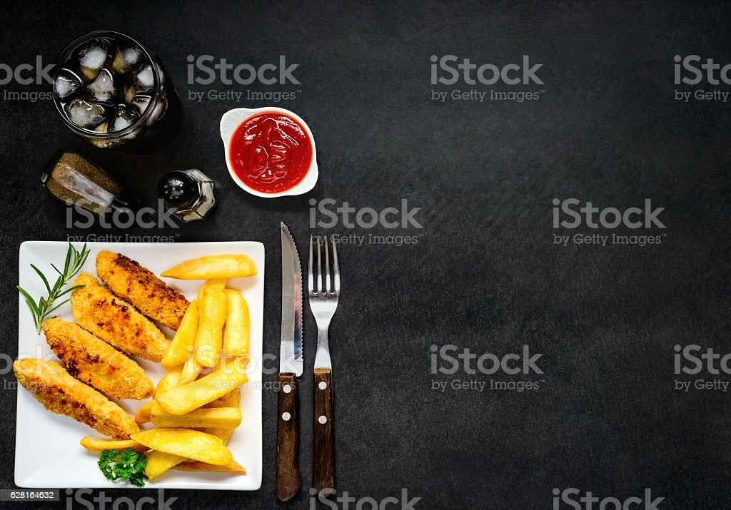 Chicken Fingers with Fried Potatoes and Copy Space stock photo